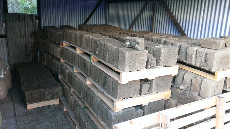 Mudbricks drying in shed
